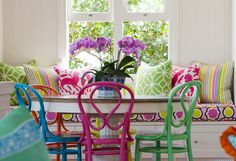 How fun is this? Colorful fun kitchen nook with built in. ~ Black & Spiro Interior Design  pink green blue kitchen   colorful kitchen   bright kitchen   interior design   green chair   pink chair   blue chair   DIY chairs