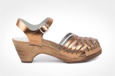 The Barcelona clog sandal has a braided front and an adjustable ankle strap.