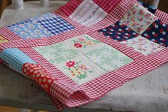 Gingham Sashing: i probably already pinned this, but it's worth repeating.  Love this cute 4 square quilt with check sashing.