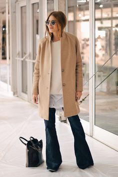 Style inspiration by 9 Ultra-Cool Ways To Wear Flared Jeans    Maja Wyh in  a camel coat, layered tops   wide-leg denim 04cc7ce95e9c