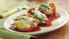 Enjoy these cheesy pasta shells stuffed with chicken and spinach - perfect for Italian dinner.