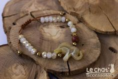 Brown cord bracelet with little elephant in earth tones, hematite, and crystal beads...  #lechataccessories #elephant #♥ #loveit #shiny #earthtones #crystalbeads #hematite #bohemianchic  © Danae Lolou  Find me on Facebook & Instagram : Le Chat Accessories for more photos. https://www.facebook.com/lechataccessoriesdanae/  https://www.instagram.com/lechataccessories/