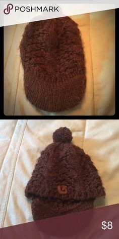 Brown knit hat This brown knit hat has a bill and puff ball on top! Accessories Hats