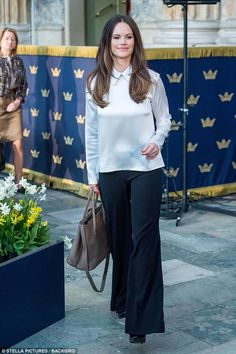 Former model Sofia, 33, who gave birth to her second son Gabriel in August last year looked svelte in a white satin top and wide-legged trousers