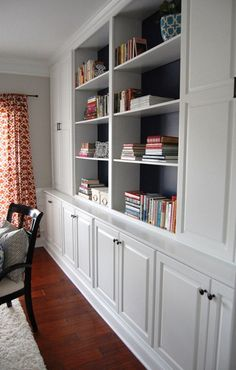 Rick and Peggy consider painting the beach glass behind the shelves of the new bookcase in the sunroom, great pop of color to accent