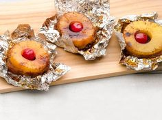 Campfire Pineapple Upside Down Cake    For each cake, mound 1 1/2 tablespoons light brown sugar and 1 tablespoon butter on a sheet of nonstick foil. Top with a pineapple ring, a maraschino cherry and an upside-down small shortcake shell. Form a packet. Grill sugar-side down   over medium-high heat, 12 minutes.