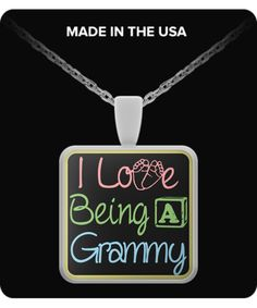 """I love being a Grammy""  Necklace/Pendant.   Attach it to your key chain, wallet, purse, hang it on your rear view mirror. There are endless possibilities for showing off your pendant."