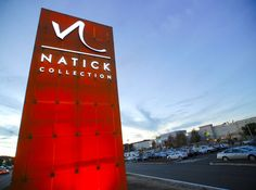 Natick Collection - RSM Design Shopping Mall Center Boston Signage Placemaking Exterior Identity Sign Logo Monument Entry Facade Directional Vehicular Awning Pylon 3form Chroma Red