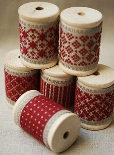 Red and white embroidery on wooden spools. By Emmanuelle Carre. As seen in Australian Homespun's April 2014 Best of the Best from Pinterest feature.
