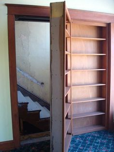 Secret Stairway behind Bookshelf  Ashley Richard could do this in his tv room on back side of stairs