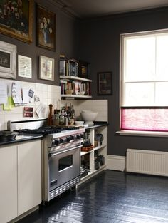 beautiful little kitchen with charcoal walls and ceiling.