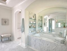 Image from http://cdn.decoist.com/wp-content/uploads/2014/04/Glass-shelves-in-a-spa-style-bathroom.jpg.