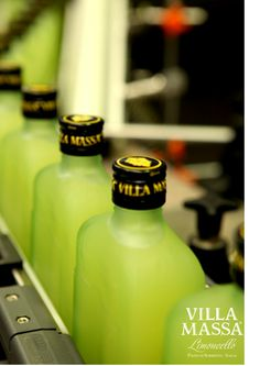 Bottling phase at Villa Massa Limoncello factory in Sorrento, Italy.