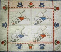 Quilt.  house with posy border`~ would make a cute doll quilt.