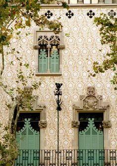 A building in Barcelona, Spain. Love the pattern on the wall and the details of the building. and...