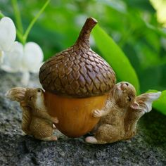 Squirrels Carrying Acorn. www.teeliesfairygarden.com . . . These adorable squirrels have found a treat! They're carrying it to their home. The fairies adore these little ones! #fairysquirrel