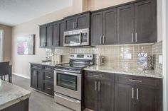 Porchlight Developments is a new home builder that focuses on building amazing communities in Regina and Winnipeg Dark Cabinets, Kitchen Cabinets, New Home Builders, New Homes, Beautiful, Home Decor, Restaining Kitchen Cabinets, Homemade Home Decor, Kitchen Base Cabinets