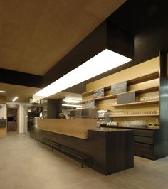 counter with rear cupboards, panelling in black steel