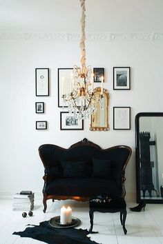 chandelier (my favorite) all white walls, fun molding, and organized wall prints!