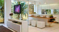 TV giratória - veja ambientes versáteis e integrados com essa novidade!