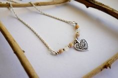 This is a unique piece with a celtic knotted heart charm.  A very romantic style necklace, with the delicacy of the small pink moonstones and transparent cracked beads. The twisted silver plated chain is the finishing touch.  Drops of faint hues and a knotted heart.