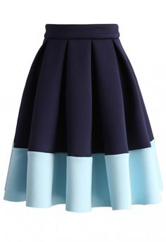 Get your color block on with this lovely pleated skirt in navy and cerulean! Pair this pretty skirt with a tucked white blouse or cropped sweater and step into knee-high boots for a delightful look! You'll be ready for a date, the office and so much more!  - Pleated silhouette - Color block design - Concealed side zip closure - 95% Polyester, 5% Spandex - Hand wash cold  Size(cm) Length Waist XS        56     64 S         56    68 M        56    72 L   …