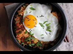 Hot & spicy Korean Kimchi Fried Rice (kimchee bokkeum bap)! Filled with bacon bits, kimchi & topped with a fried egg. You've got to try this.