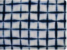 Itajime shibori is a shaped-resist technique. Traditionally, the cloth is sandwiched between two pieces of wood, which are held in place wit...