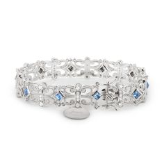 """Finish your wedding day look with our personalized """"Something Blue"""" Pave Filigree Bracelet. This luxe bracelet features a filigree design covered with clear pave crystals, and pops of blue crystals. Make it extra special when you engrave your new name, monogram, or the date on the small charm at the clasp. https://www.thingsremembered.com/blue-crystal-filigree-bracelet/product/342503?fcref=pinterest"""