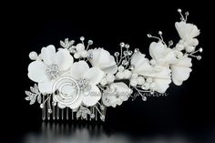 This beautiful bridal comb has matte satin flowers and buds surrounded by rhinestone sprays and jeweled leaves. Fabric pearls add a unique accent. It is 6 inches long, flexible and inches high. Flower Hair Accessories, Hair Accessories For Women, Wedding Hair Accessories, Bridal Comb, Bridal Headpieces, Wedding Hair Flowers, Flowers In Hair, Rhinestone Fabric, Lace Ribbon