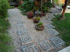 viele ziersteine verwenden einzelne trittsteine auflegen pflanzentöpfe