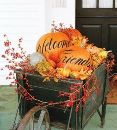 Make a weathered wheelbarrow into a welcoming fall arrangement! Details: http://www.midwestliving.com/homes/seasonal-decorating/pumpkin-decorating-projects?page=1