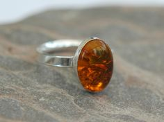 Sterling Silver Ring with Amber,  size O-P,  slight second,  R125 £16.00