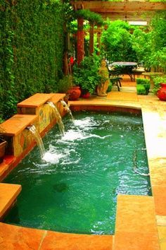 Tiny pool with waterfall feature. This would work and maybe even work for a tiny budget. With solar heating, of course.: