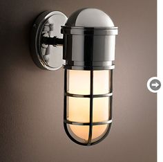 caged sconce from Restoration Hardware. Its industrial vibe would be perfect for use in a chic loft or minimalist space.