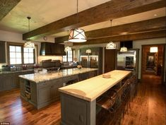 Kitchen in a 100 million dollar log home. belongs to one of Koch Bros.