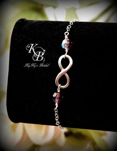 Choose her birthstone to make this Sterling Silver Infinity Bracelet an extra special Bridesmaid Gift. SHOP NOW ~ https://www.etsy.com/listing/192609788/birthstone-infinity-bracelet-infinity
