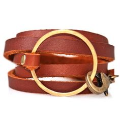 Wrap Bracelet Honey, $29, now featured on Fab. This high-quality leather bracelet coils around the wristfive times and comes together with a brass ring and an oversized lobster clasp. This industrial-style piece is for the girly-girl who likes things a little rough around the edges.
