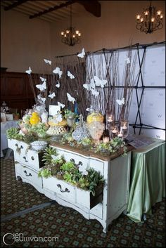 Sticks with butterflies~~make a great centerpiece.  I cannot wait to have parties where I can do this!  #buffet centerpiece #garden theme #wonderland #butterfly