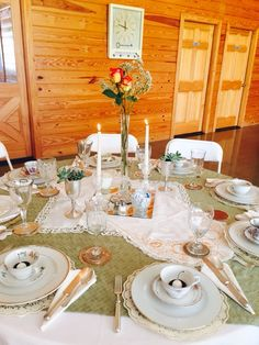 Lots of layering was done here to make this beautiful table setting.  A new white tablecloth is topped with a square of upholstery fabric followed by vintage runners. All this was adorned with coffee stained paper doilies, mirror, glass, silver and vintage tea cups. You can't go wrong with this combination.