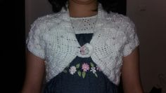 A shrug with pearl buttons