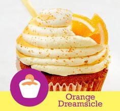 Orange Dreamsicle  Cake: Orange  Filling: Whipped Cream  Topping: Vanilla and Orange Buttercream Swirl, Orange Candy Slice and White Chocolate Straw #cupcakesup