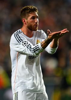 Sergio Ramos Photos Photos - Sergio Ramos of Real Madrid celebrates scoring their first goal in stoppage time during the UEFA Champions League Final between Real Madrid and Atletico de Madrid at Estadio da Luz on May 24, 2014 in Lisbon, Portugal. - Real Madrid v Atletico de Madrid - UEFA Champions League Final