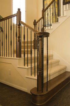 This staircase design was created using Tuscan square hammered balusters. The single twisted knuckle bar (2.9.12), the double twisted knuckle baluster (2.9.13), and the plain square hammered baluster (2.9.20) create a uniquely designed staircase. These components are available in Satin Black (shown), Copper Vein, Oil Rubbed Bronze, Oil Rubbed Copper, Satin Clear, and Vintage Brass. We offer parts, install services, and custom components throughout Texas. Click the image for more information.