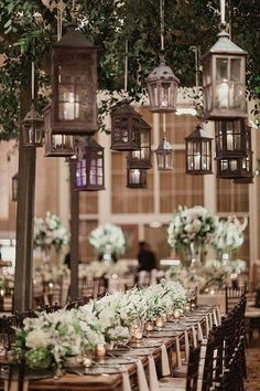 I love this indoor outdoorsy wedding reception theme. Lanterns and ficus trees everywhere!