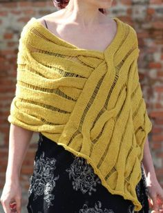Knitting Pattern for Lara Poncho - This modern poncho uses cables and drop stitches to create a dramatic look. The designer says this poncho is very easy to make. DK yarn. Designed by GAMMAstudio