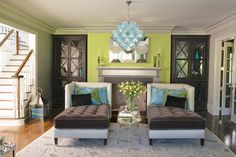 Colors are great, and I really dig the mirrored sofa chaises....what a fun space!