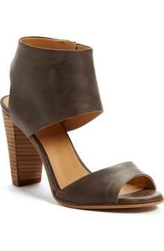 A chunky leather cuff at the ankle modernizes this versatile sandal lifted by a stacked heel.