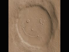 Martians obviously have a sense of humor. This 2-mile-wide (3 km) unnamed crater was photographed in 2008 by the Mars Reconnaissance Orbiter.