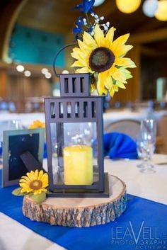 lantern and sunflower wedding centerpieces... LOVE this!! (Amber Bottle Centerpieces)